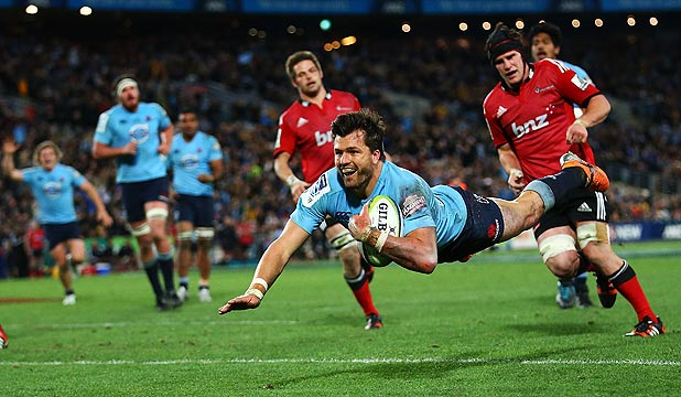 YOU BEAUTY: Man of the match Adam Ashley-Cooper dives over to score his second try for the victorious Waratahs in the Super Rugby final against the Crusaders.