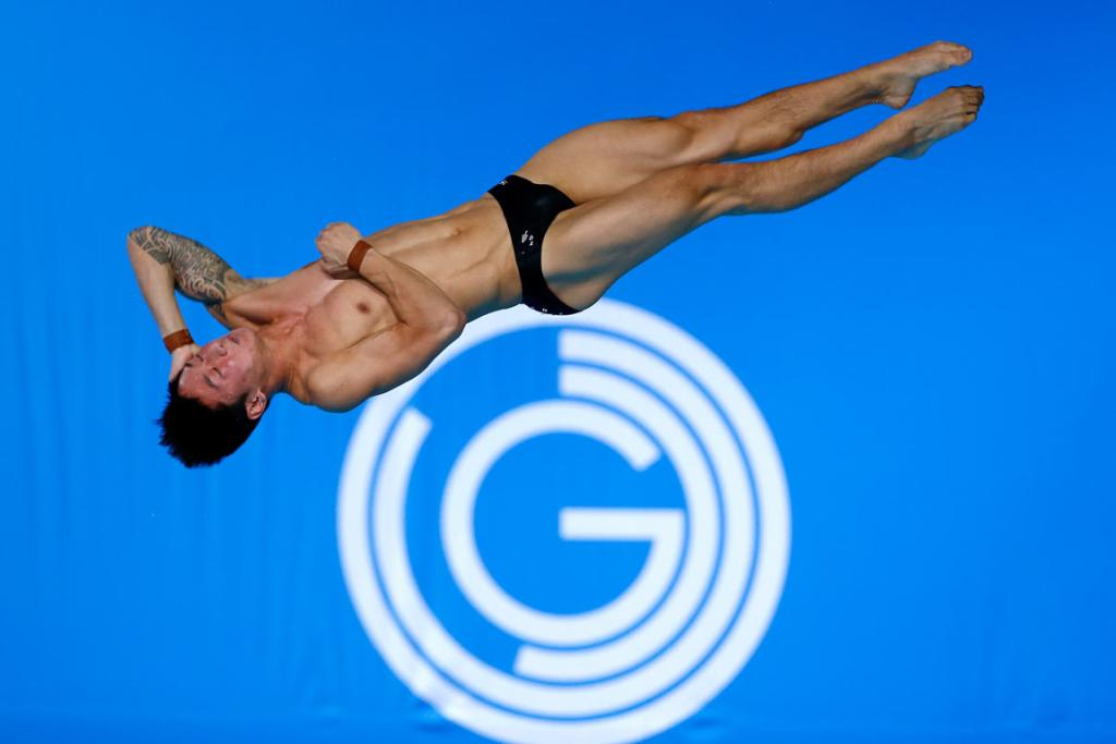 New Zealand's Li Feng Yang twists and flips during a dive in the men's 10m platform preliminaries in Edinburgh.