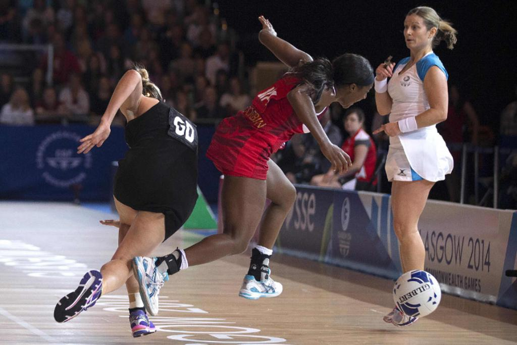 New Zealand captain Casey Kopua collides with England wing attack Sasha Corbin.