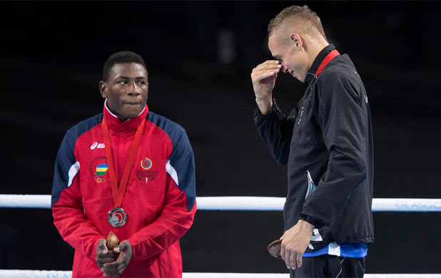 TEARS OF JOY: David Nyika tears up on the medal dais after winning gold in the light heavyweight final.