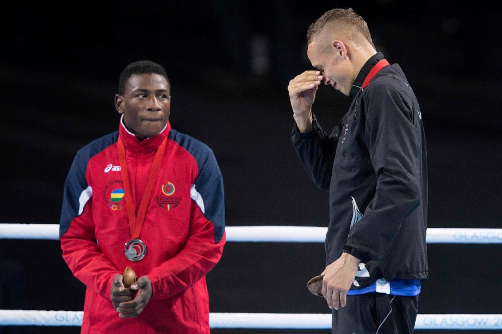 David Nyika tears up on the medal dais after winning gold in the light heavyweight final.