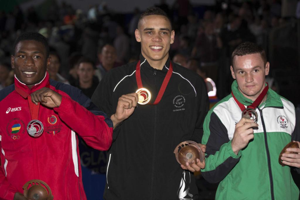 David Nyika with silver medalist Kennedy St Pierre of Mauritius (left) and bronze medalist Sean McGlinchy of Northern Ireland.