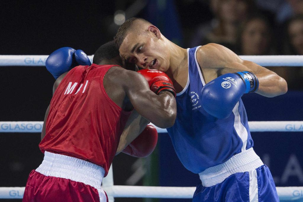 David Nyika in action against Kennedy St Pierre of Mauritius in the light heavy gold medal bout.