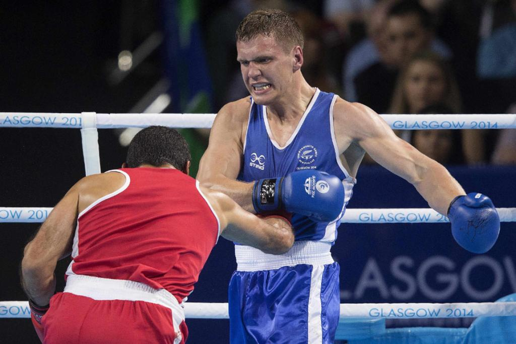 Kiwi David Light evades a punch and look to throw a left hook of his own against Samir el-Mais of Canada.