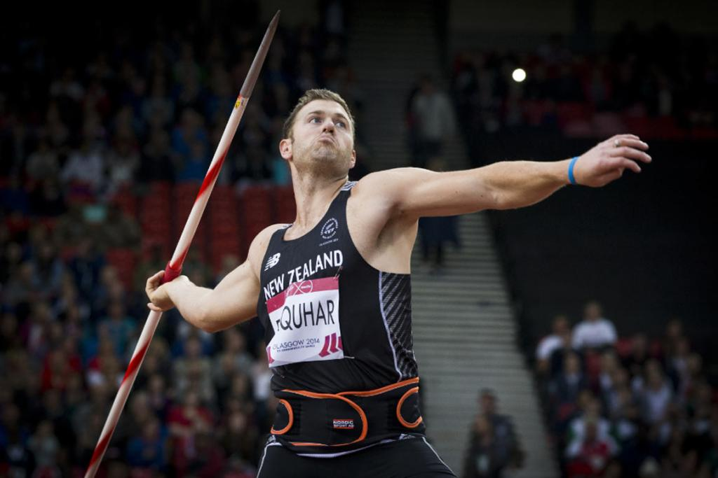 Stuart Farquhar flings the javelin during the men's final at Hampden Park.