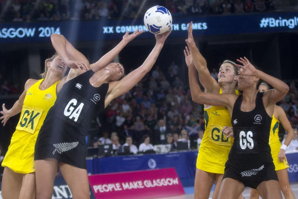 Silver Ferns goal attack Jodi Brown and goal shoot Maria Tutaia reach for the ball in the shooting circle.