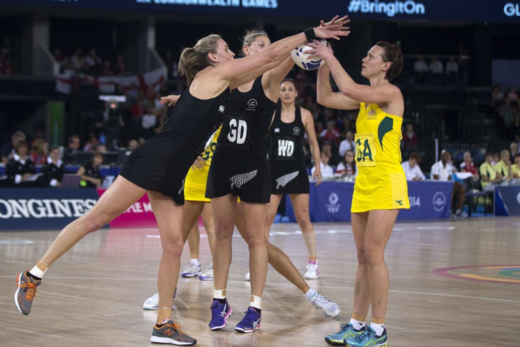 Silver Ferns defenders Casey Kopua (left) and Leana de Bruin both block the shot attempt of Natalie Medhurst.