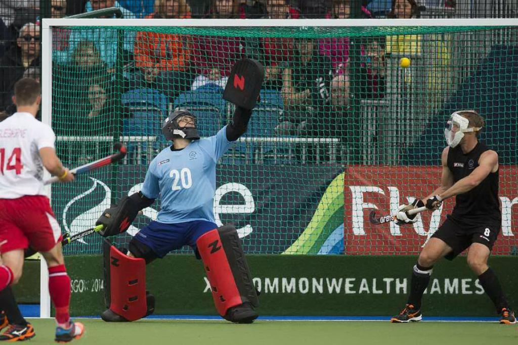 Black Sticks goalkeeper Devon Manchester and captain Dean Couzins cannot stop a high England shot.