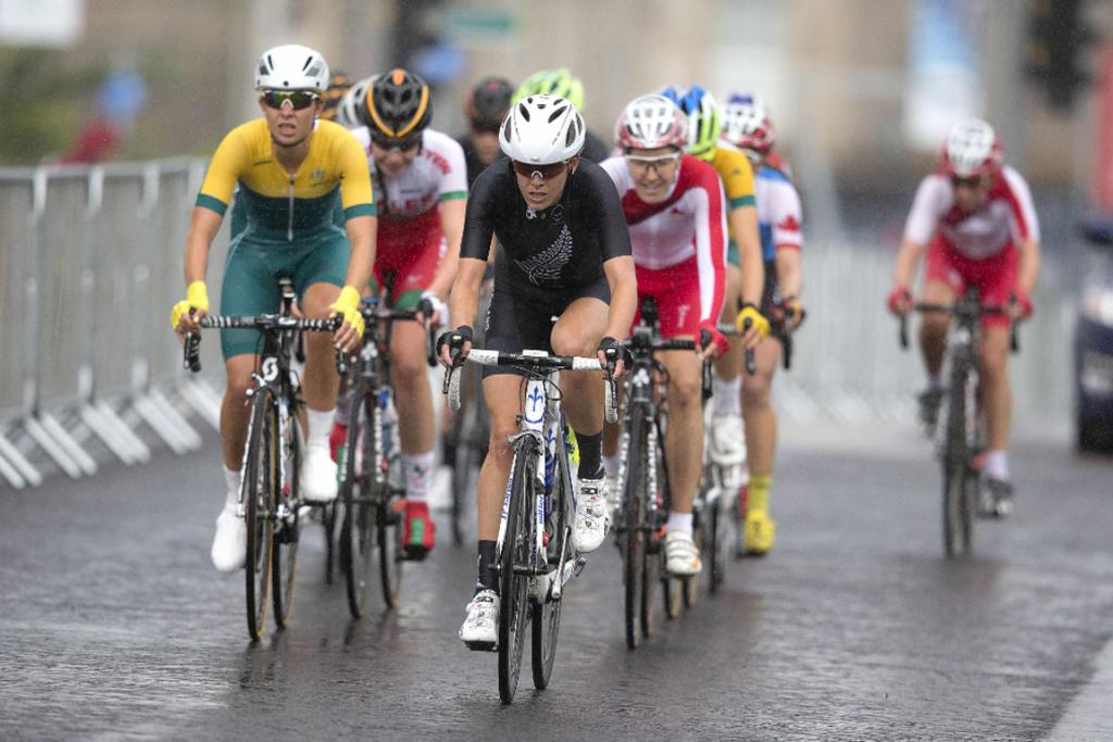 New Zealander Emily Collins rides at the front of the peloton during the women's road race.