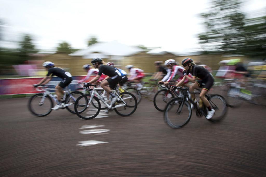 New Zealand riders speed past during the women's road race.