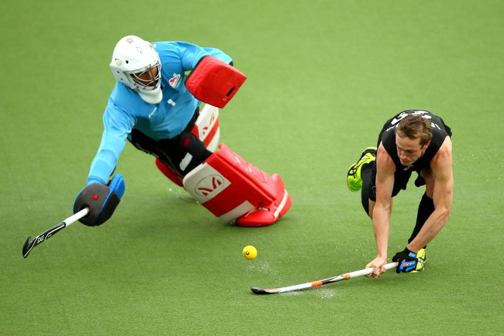 New Zealand's Hugo Inglis successfully makes his shot during the bronze medal shootout.