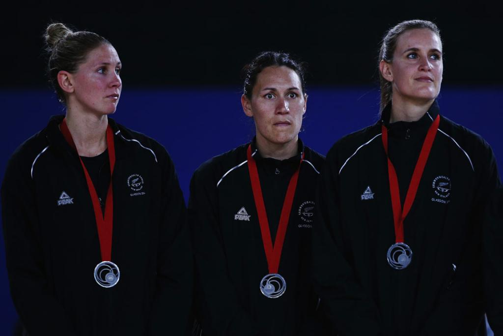 The silver medals sit awkwardly around the necks of Silver Ferns Casey Kopua, Jodi Brown and Leana de Bruin.