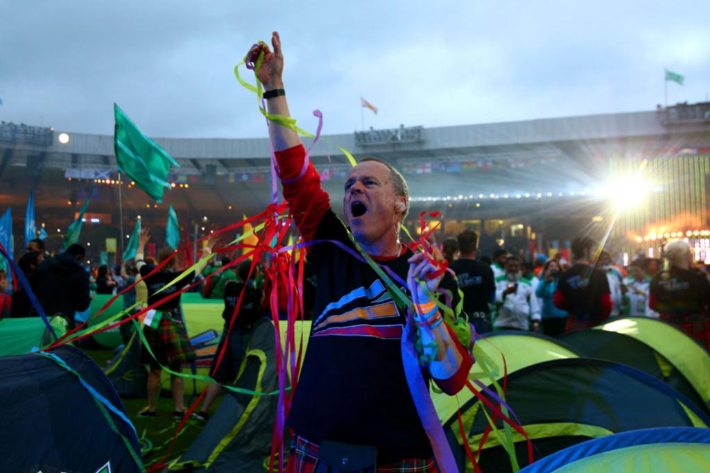 A reveller relishes the party at Hampden Park.