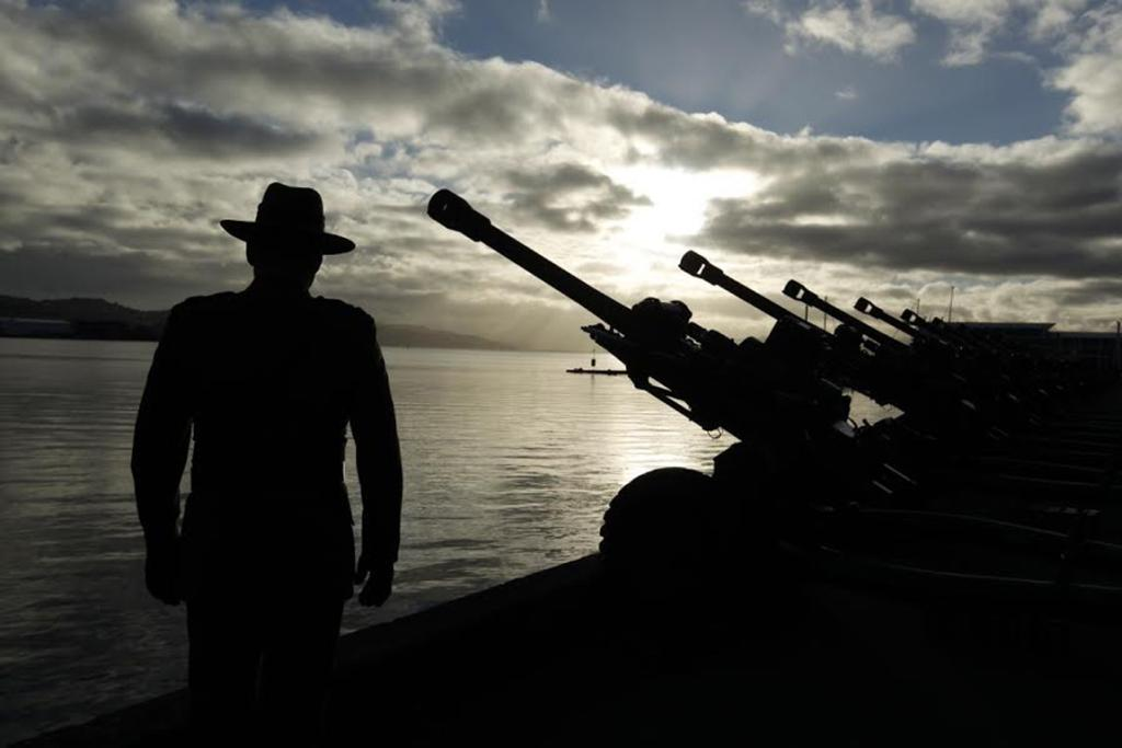 A soldier stands guard by the guns on Wellington waterfront, in preparation for 100-gun salute.