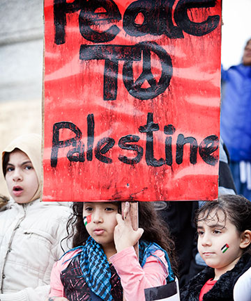 PEACEFUL PROTEST: Yasmen Elidirisi, 9, and Rital Assad, 6, at the the Palmerston North March for the Children of Gaza.