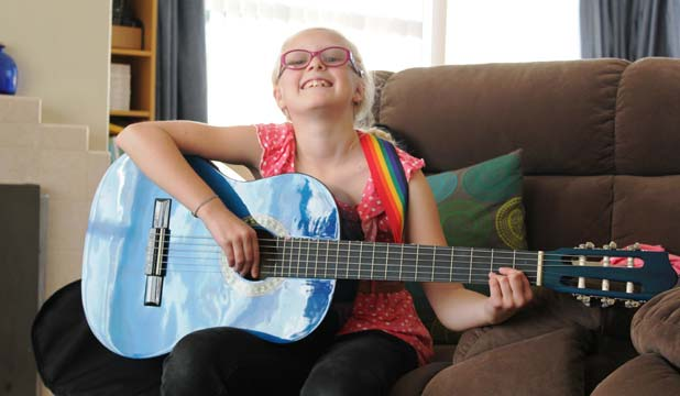 BRAVE KID: Ten-year-old Katie Reed suffers from a serious lung condition. She says hospitals can be scary at times but she'd like to use her experiences to become a top-notch doctor – failing that she'll settle for a career as a guitarist and singer.