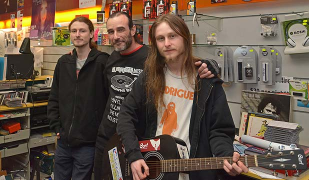 I'VE HAD ENOUGH: Monster The Who fan and record shop owner Paul Zwaig, centre, with his sons Ben, left, and Sam.