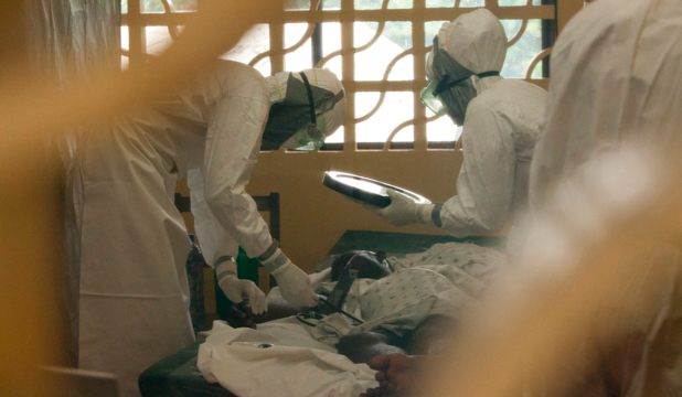 DEADLY ILLNESS: Doctors, wearing personal protective equipment, treat Ebola patients at the case management centre in Monrovia, Liberia.