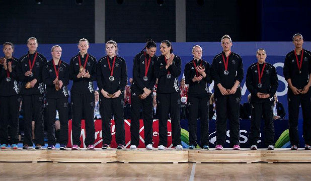 GLUM GATHERING: The Silver Ferns in sombre mood after receiving their silver medals.