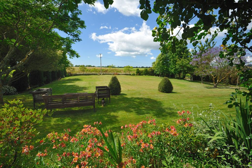 The large flat lawns are perfect for a variety of outdoor activities - backyard cricket anyone?