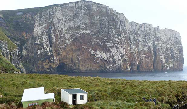 ANTIPODES ISLANDS: A remote hut, damaged in a landslip, needs repair.