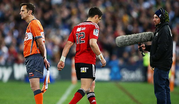 DEJECTED: Dan Carter limps off during the Super Rugby final. Is the All Black maestro's dream of playing in and winning the 2015 Rugby World Cup over?