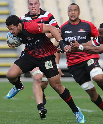 COMING THROUGH: Canterbury wing Milford Keresoma breaks a tackle against Counties Manukau before his season-ending injury in 2013.