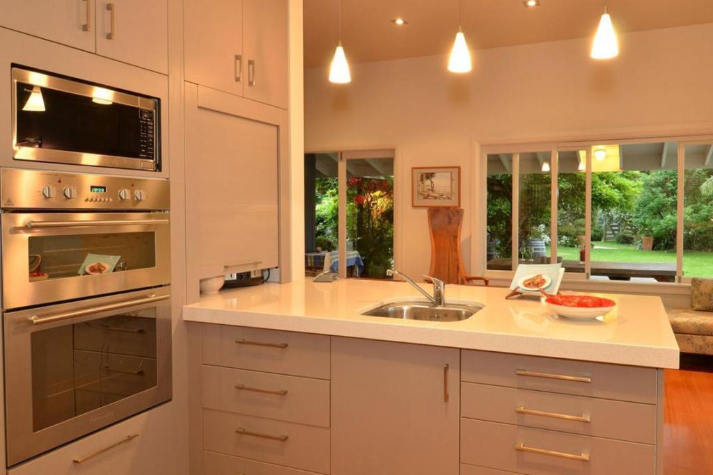 The kitchen is a lovely light space with a beautiful view out to the garden.