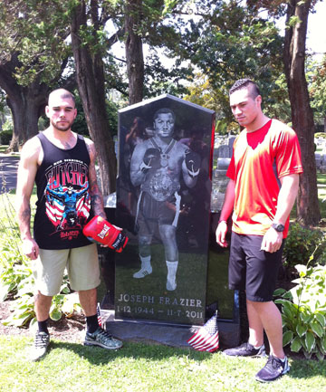 PAYING RESPECT: Kiwi fighters Robbie Berridge, left, and Joseph Parker at former world heavyweight champion Joe Frazier's grave.
