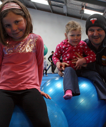 SPECIAL TIME: Active Dad John Pontague with his daughters Lilly, 5, and Brooke, 4, have fun at the Blenheim Gymnastics Club Kindy Gym session.