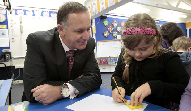 PHOTO WITH THE PM: Prime Minister John Key visiting Discovery School in Whitby speaks with year 2 Discovery School Whitby student Annelise Pardy, 6.