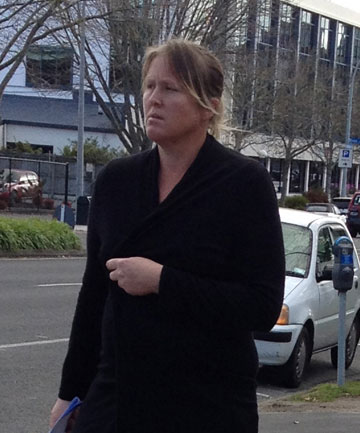 LIGHT FINGERED: Former bar manager Jane Hamilton leaves the Hamilton District Court.