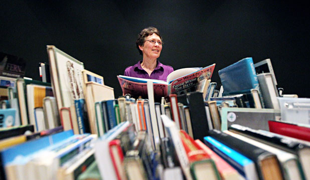 BYE BYE BOOKS: Delwyn Singh is ready for a busy weekend at New Plymouth's final 24 Hour Book Sale.