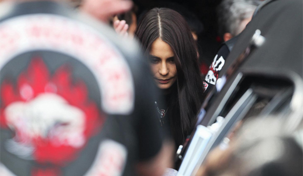 SAYING GOODBYE: Millie Elder-Holmes at the funeral of her boyfriend Connor Morris.