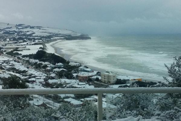 Snow blankets South Dunedin and St Kilda beach.