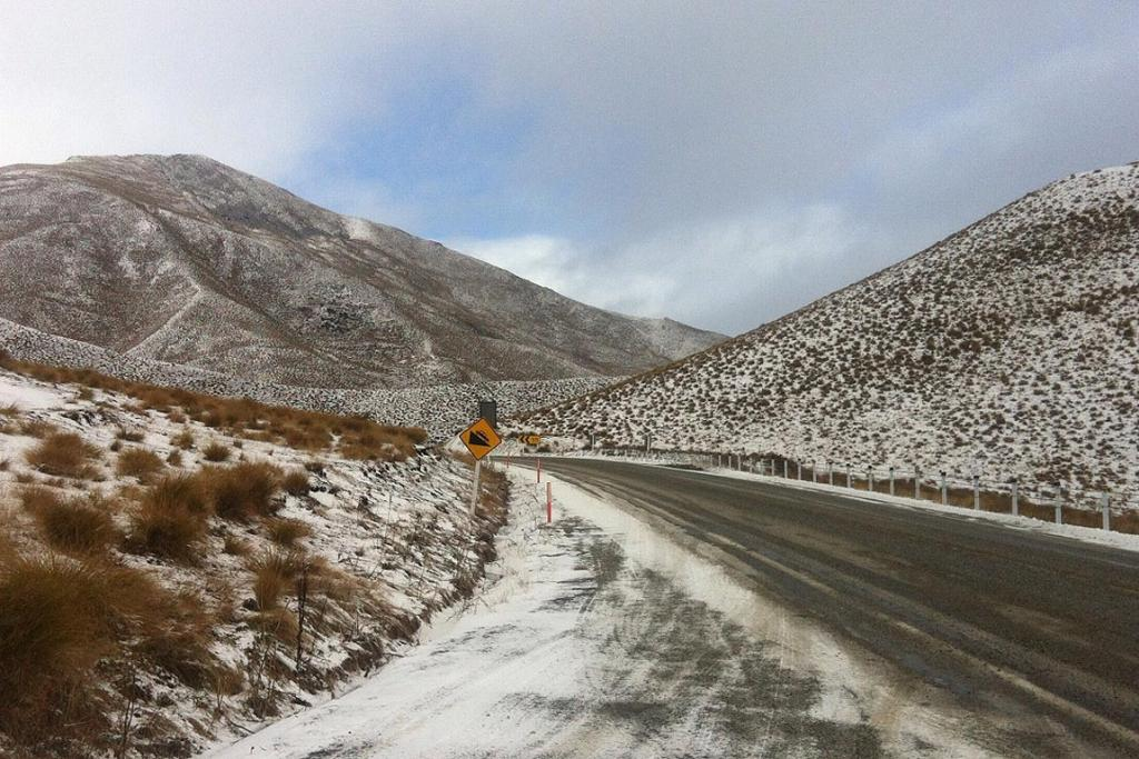 Snow covers the hills in the Lindis Pass.