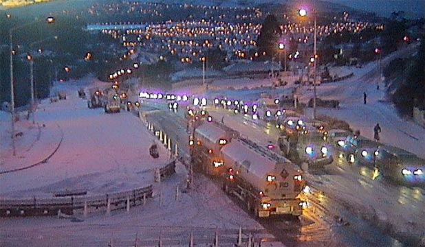SLIPPERY TIMES: Snow coats Mornington Rd in Dunedin in this webcam image from NZTA.