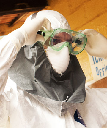 HEALTH WARNING: person in a protective suit works at an Ebola isolation ward at a mission hospital outside of Monrovia, Liberia.