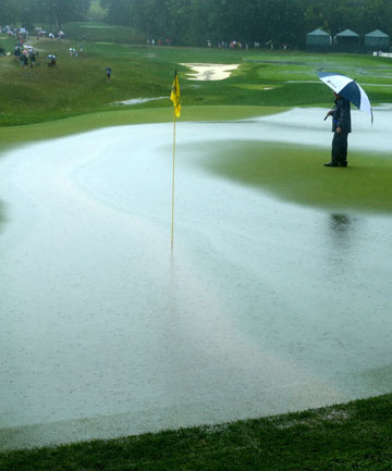 SOGGY STUFF: The ninth green at Valhalla soon after a deluge on the morning of the final round of the PGA Championship.
