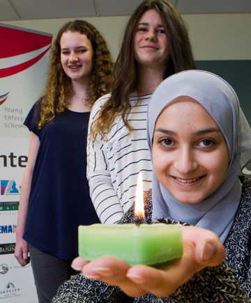 BRIGHT IDEA: Hamilton Girls High School students Paige Taylor, 16, Rebekah Marsden, 16, and Hajer Bahr, 16, from Centsation with candles.