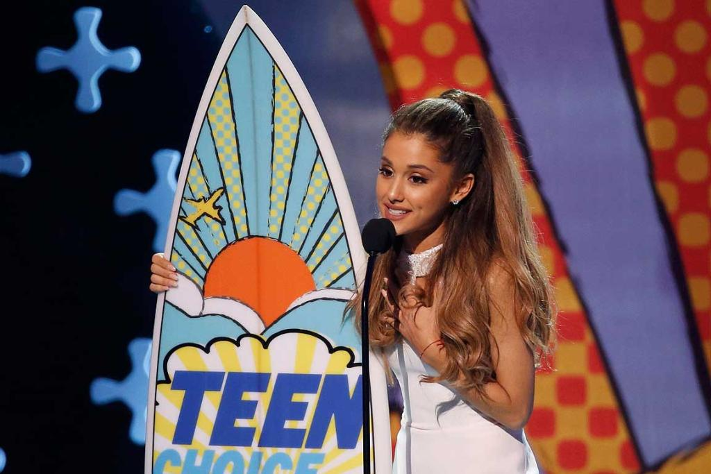 "Ariana Grande accepts the award for choice female artist for ""Problem"" during the Teen Choice Awards."