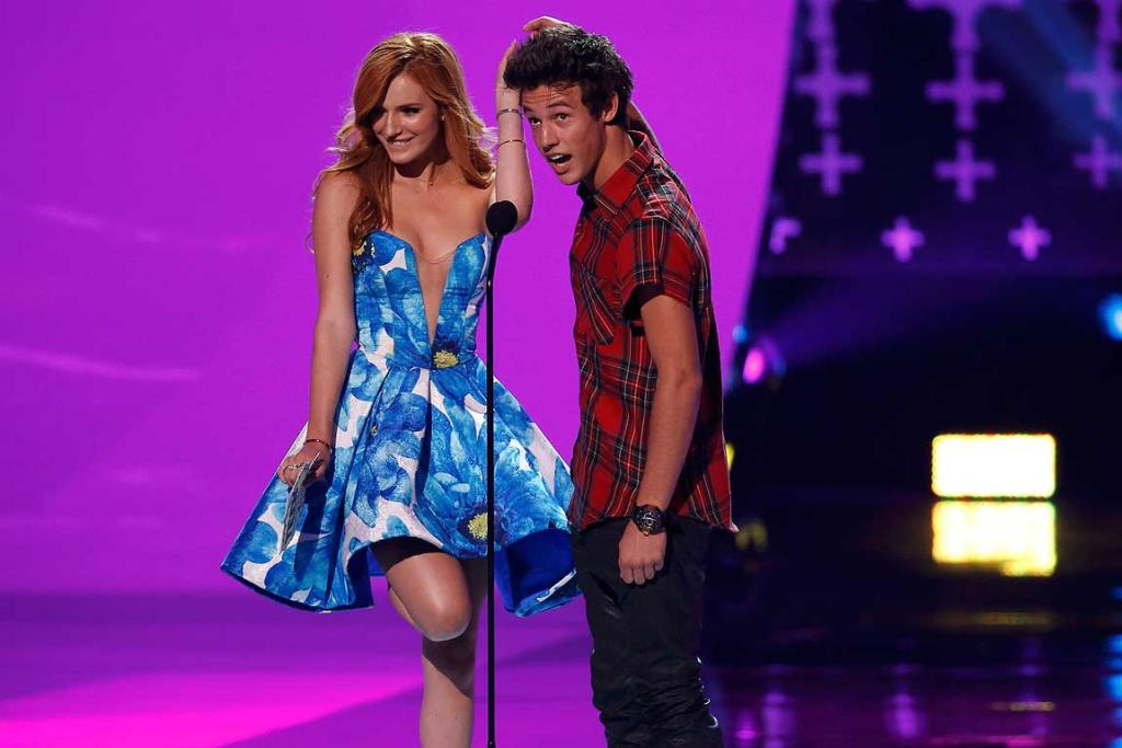 Bella Thorne, left, and Cameron Dallas present the award for choice style icon during the Teen Choice Awards.