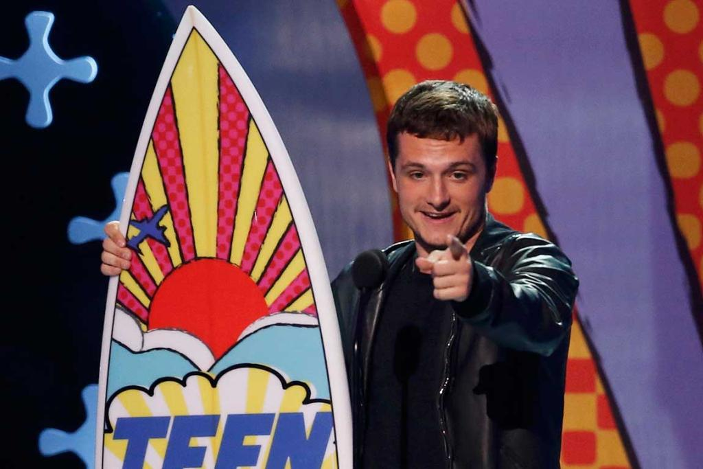"Josh Hutcherson accepts the award for choice movie actor: sci-fi/fantasy for ""The Hunger Games: Catching Fire"" during the Teen Choice Awards."