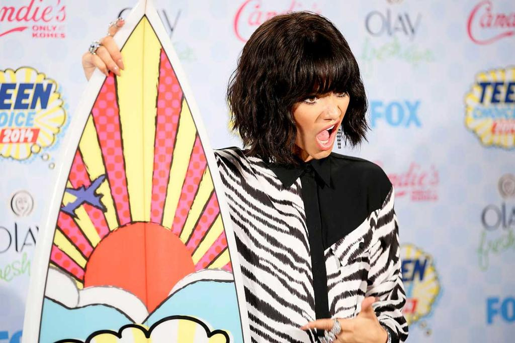 Zendaya poses backstage after winning the Candie's Choice Style Icon award during the Teen Choice Awards.