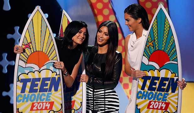 TEEN FAVOURITES: Kylie Jenner, Kim Kardashian and Kendall Jenner accept a Teens Choice Award.