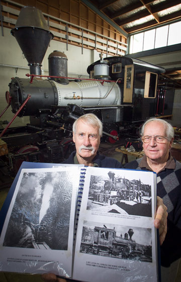 CHUGGING ALONG: From left, Ken Williamson and Allen Cartwright are nearing the end of the  restoration of Te Awamutu's Climax 1317 train.