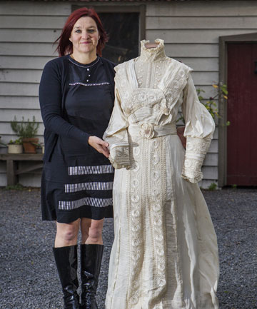 IN THE FAMILY: Deborah Gill-Smith with her family heirloom wedding dress.