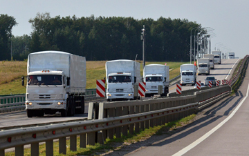 UNWANTED: A Russian convoy of trucks carrying humanitarian aid for Ukraine drives along a road near the city of Yelets on Monday.