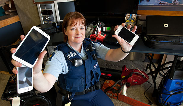 NEW HOMES: Constable Tina Lord with some of the stolen goods to be auctioned off if not claimed.