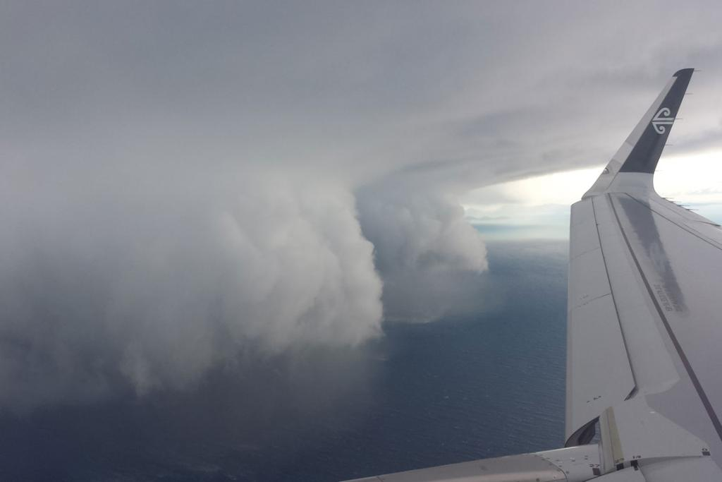 ROLLING IN: A passenger took this shot from their plane seat of the storm arriving over the harbour.